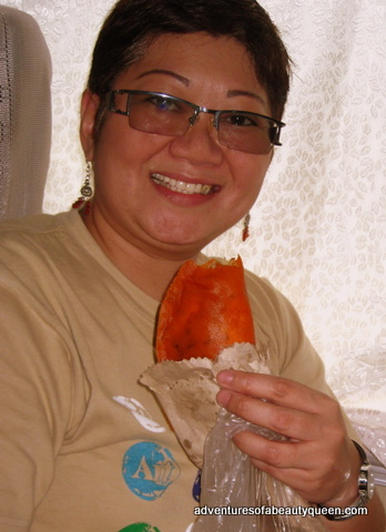Hazel Alviz of the Philippine Bible Society with a Batac Empanada