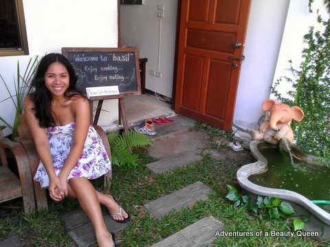 Diandra at the entrance of Basil Healthy Thai Cookery