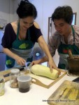 Tom teaches me how to scrape unripe Papaya for my Som Tam Salad