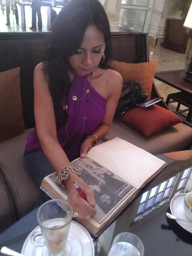 Cita Capuyon signing Tony's memorabilia of her...