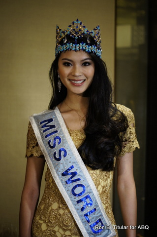 Miss World 2013 Wenxia Yu wore a lacy gold dress when she welcomed the press in Manila Hotel