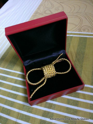 Lovely little gift from BPCI - a gold ribbon brooch...