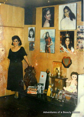 Mom posing next to her collection my beauty queen photos and memorabilia...