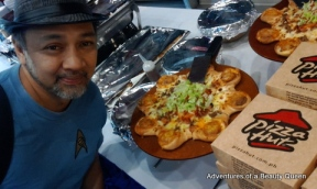 Ron with the new, delectable Cheeseburger Pizza from Pizza Hut!