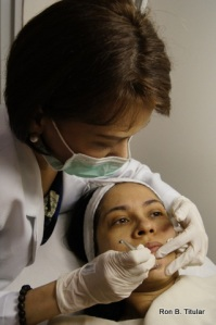 That's me under the meticulous hands of Dr. Shae Raymundo having a facial and Diamond Peel
