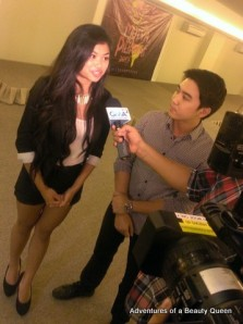 Allison Almario of  Fil-Canada with Jefferson Tan of Mutya ng Pilipinas being interviewed by media