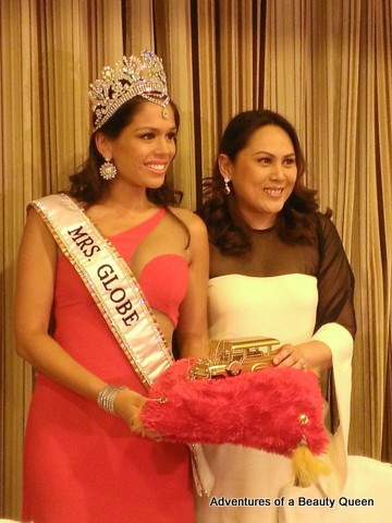 Mrs. Globe 2013 Sheryl Lynn Baas recieves a bronze jeepney from Mrs. Globe Philippines National Directress Carla Cabrera Quimpo...  because the journey continues...