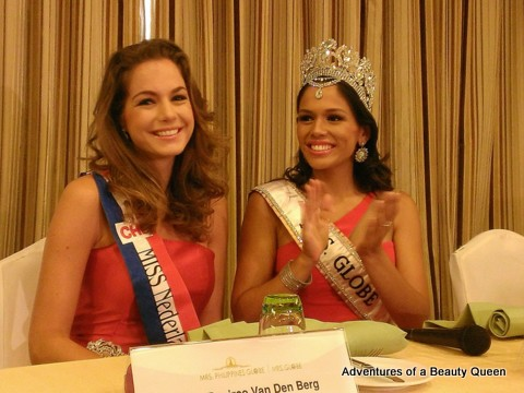 Mrs. Globe 2013 Sheryl Lynn Baas (with crown) claps as her best friend Miss Netherlands 2010 Desiree Van Den Berg is introduced to the press...