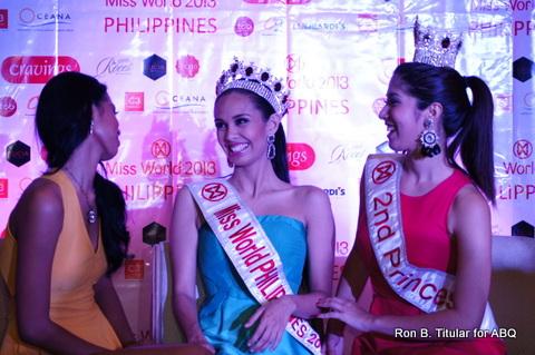Megan Young enjoys a light moment with her 1st Princess Janicel Lubina (left) and 2nd princess Zahra Bianca Saldua (right)