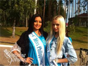 Mutya Datul (left) with the representative of host country Belarus...