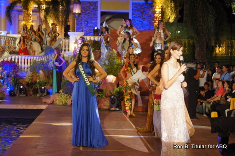 3. Miss Earth 2008 Karla Henry (in white) gives a short speech on Yolanda thanking all the nations as represented in the pageant for coming to the aid of the Philippines when it was at its darkest hour.