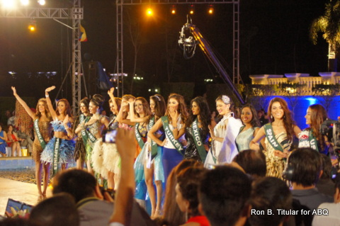 4. The Top 16 contestants at Miss Earth 2013 wave to the audience...