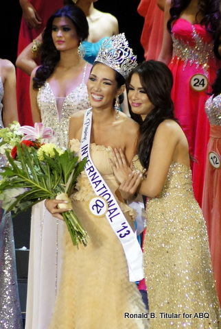 Bea Santiago shines like the sun after Nicole Schmitz passes on the Bb. Pilipinas International crown to her...