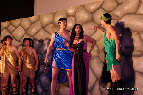 Queen Jocasta, as if to protect the hulking King Oedipus from her shorter brother Creon...