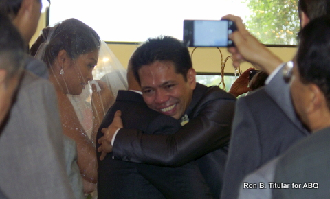 Right before recieving his bride, Ardy Roberto quickly hugs his Dad. Meantime, Miriam Quiambao  wipes away a tear ...