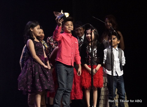 Bugoy Carino (holding the award) recieves a Golden Dove for their children's tv show.