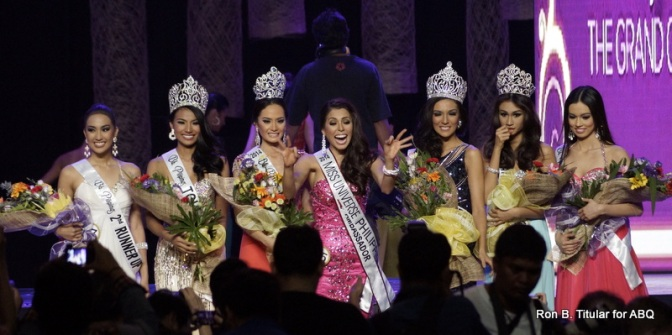 MJ Lastimosa loses her crown for a moment while the girls get ready for their first photo as beauty queens!
