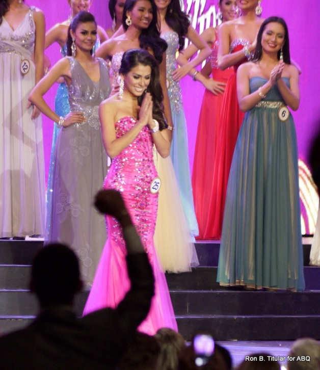 MJ Lastimosa gestures gratitude to the judges as she is  announced winner of the Best in Swimsuit award...