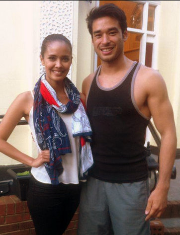 John Spainhour with Miss World 2013 Megan Young during a break at the Mr. World 2014 competition...