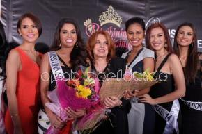 Stella Marquez Araneta in the middle with MJ Lastimosa beside her wearing her Miss Universe Philippines sash
