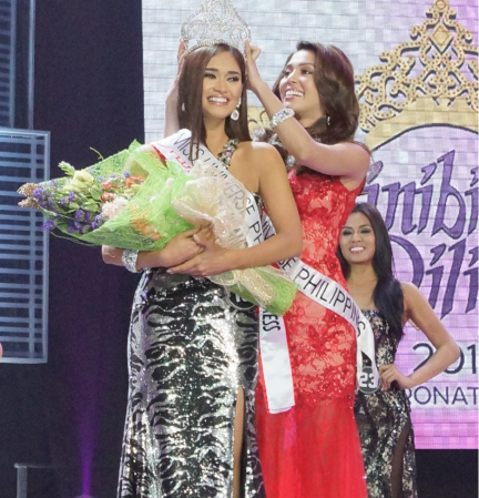 Finally... to feel that crown she worked so hard for! Pia Wurtzbach is crowned Bb. Pilipinas Universe 2015 by her predecessor MJ Lastimosa...